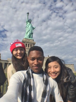 Students with Statue of Liberty in background.
