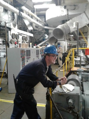 Photograph of cadet in machinery space.