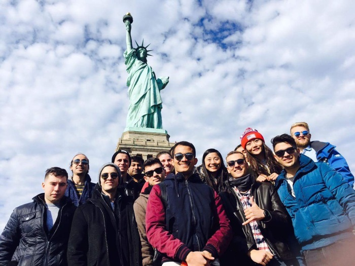 Students in front of Statue of Liberty.
