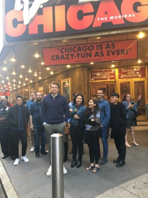 Students stand outside of the theater for the musical Chicago on Broadway.