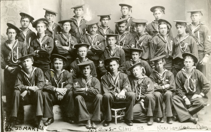 Image of students in uniforms posed for group photo.