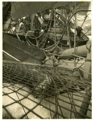View of ship from rigging.