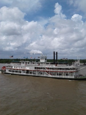 Image of a vintage Mississippi river paddle wheel boat on the river.