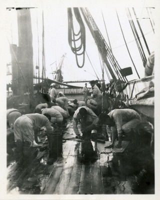 Image of cadets cleaning deck.