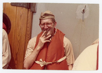 man in life jacket smoking cigar