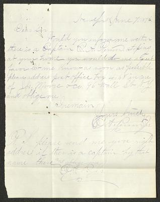 The letter is handwritten in blue ink on cream-colored paper with faint blue lines. It has been folded several times