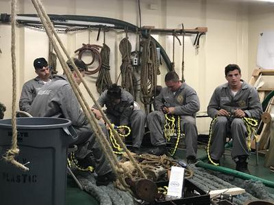 1st Class (Senior) Cadets are splicing (braiding) lines in Maintenance and Repair Lab with one of the instructors.