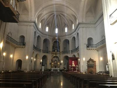 Interior view of the nave, apse, and altar in San Nicolas de Bari Procathedral in Alicante.