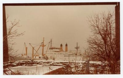 In a distance, there lies the Training Ship Empire State V. The ground is also covered with a thin layer of snow.