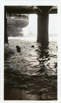 A view of the SS Morro Castle under a dock