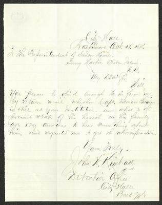 The letter is handwritten in grayish-brown ink on cream-colored paper with blue lines. It has been folded several times. There are several small brown smudges in the upper right portion of the letter.