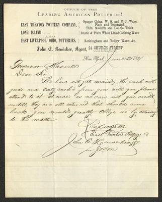 The letter is handwritten with dark brown ink on John E. Heuacker's business letterhead, which is printed on cream-colored paper with blue lines below the header. The sheet has been folded several times.