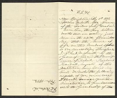 The letter is handwritten in brown ink on cream-colored paper with faint blue lines. It has been folded in half; on the right half of this side of the paper is the first part of the letter. On the left half, oriented in the opposite direction as the letter's text, is a notation just to the side of the central vertical fold, with the name of the sender and date, probably for filing purposes.