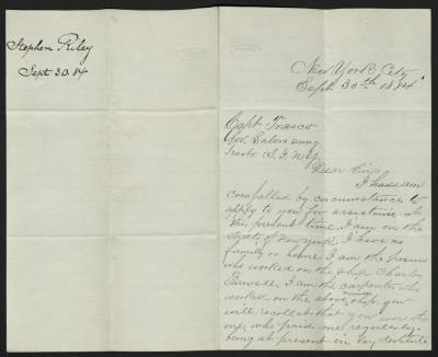 The letter is handwritten in blue ink on cream-colored paper with faint blue lines. It has been folded in half; on the right half of this side of the paper is the first part of the letter. On the left half is a notation in the upper left corner with the name of the sender, date, and subject of the inquiry, probably for filing purposes.