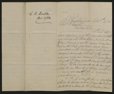The letter is handwritten in brown ink on cream-colored paper with blue lines. It has been folded in half; on the right half of this side of the paper is the first part of the letter. On the left half is a notation at the upper edge, just to the left of the central fold, with the name of the sender and the date, probably for filing purposes.