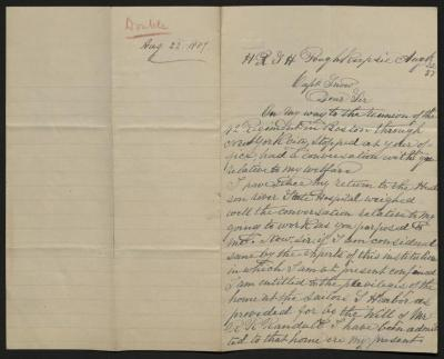 The letter is handwritten in brown ink on cream-colored paper with blue lines. It has been folded in half; on the right half of this side of the paper is the first part of the letter. On the left half is a notation at the upper edge, just to the left of the central fold, with the name of the sender, written in red pencil, and the date, probably for filing purposes.