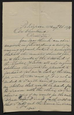 The letter is handwritten ingray ink on cream-colored paper with faint blue lines. It has been folded several times and a prominent fold divides the sheet in half vertically.