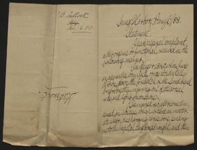 The statement is handwritten in brown ink on cream-colored paper with blue lines. It has been folded in half; on the right half of this side of the paper is the first part of the statement. On the left half is a notation at the upper edge, just to the left of the central fold, with the name of the writer and the date, probably for filing purposes.