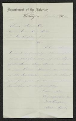 The letter is handwritten with light purple ink on Department of the Interior letterhead, which is on cream-colored paper with faint blue lines below the header. The sheet has been folded several times and has a distinct vertical fold dividing the paper in half.
