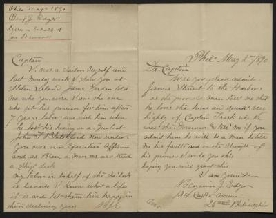 The letter is handwritten in brown ink on cream-colored paper with blue lines. It has been folded in half. Both halves are signed pages of the letter. In the upper left corner is a notation with the name of the sender, subject, and date, presumably for filing purposes.
