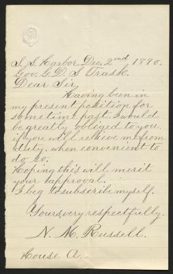 The letter is handwritten in grayish-brown ink on cream-colored paper with faint blue lines. It has been folded several times.