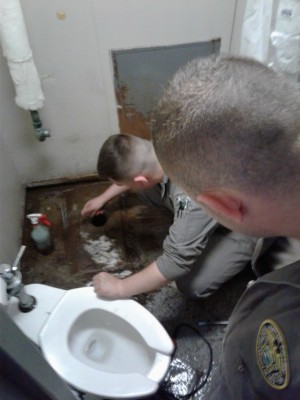 Ultility Rates (Plumbing Cadets) work on and service a toilet.