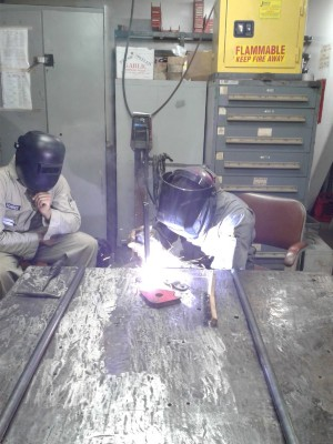 A first class cadet practices welds