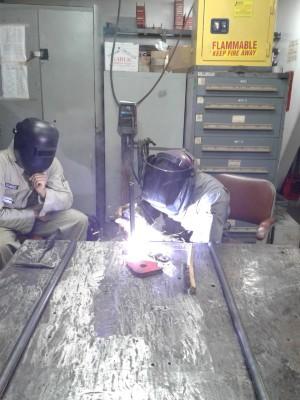 A first class cadet practices welds