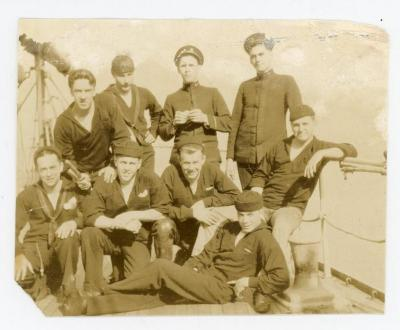 Eight student mariners in two rows of four wearing uniforms and posing for the camera.