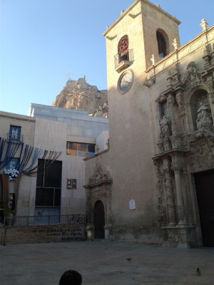 Church in Alicante. Behind the church is a castle on at the highest point in the city.