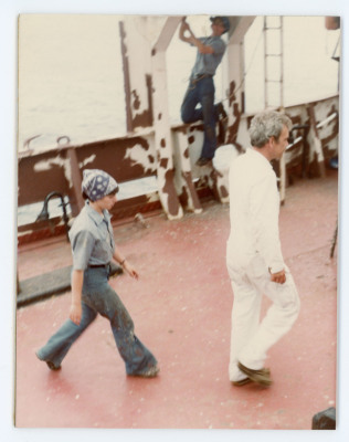 image of two people walking across the deck