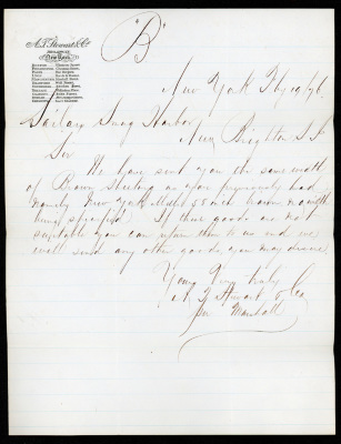 The letter is handwritten in brown ink on cream-colored paper with faint blue lines. In the upper left corner is the A.T. Stewart & Co. heading.